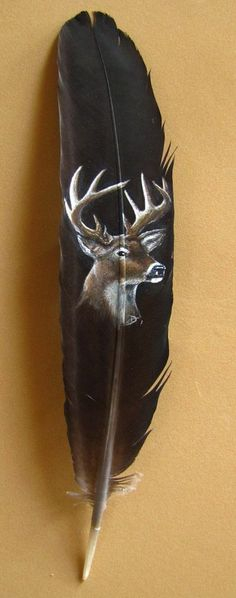 White-tailed deer painted on a peacock wing feather with acrylics.