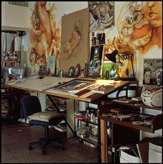 Large art on the walls, the drafting table set up and the naturaly light make me Love the artwork and the work space!