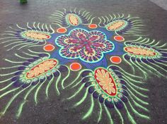Colourful Sand Mandala - incredible art created with coloured sands onto footpaths.     This has beautiful symmetry and potential for bead design.