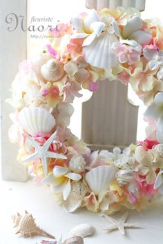 Plumeria Hydrangea shell wreath 紫陽花とプルメリアの貝殻リース by corine Seashell Wreath, Seashell Crafts, Beach Crafts, Floral Wreath, Beach Wedding Decorations, Wedding Beach, Coastal Christmas, How To Preserve Flowers, Arte Floral
