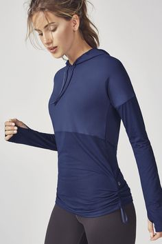 Your favorite mesh-combo style, now in a hoodie. This throw-on-and-go essential will keep you fresh all the way to the finish line. Enjoy the same cinchable sides and sweat-wicking fabric that you love. | Fabletics Cashel Hoodie