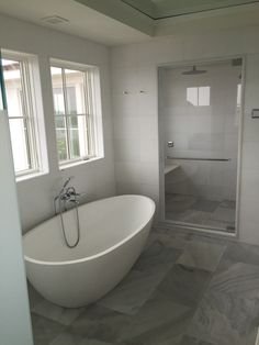Gorgeous bathroom design with freestanding tub and walk in shower all with Waterworks trim by Montauk Plumbing