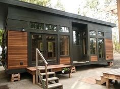 This is the 450 sq. ft. Waterhaus Prefab Tiny Home designed by GreenPod Development and built by Sprout Tiny Homes. - gorumpl.com -
