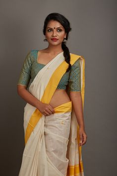 A simple square necked blouse made enchanting with tiny yellow flower motifs.THE KAITHARI PROJECTHandwoven, designed and tailored in KeralaPure cottonSleeve . Indian Bridal Sarees, Indian Beauty Saree, Indian Saris, Peter Pan Dress, Aunty In Saree, Saree Models, Desi Models, Saree Dress, Set Saree