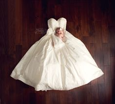 Newborn baby girl photo in my wedding dress