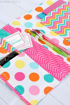 I love this!!! I so wish i could do this. All the colors (polka dots are a bonus), pens and notebooks and organization and sewing! Put it all together and what do you get? An On the Go Organizer!