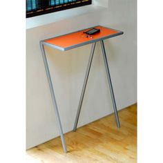 Interesting console table to put by front door? Wish it had a different color on top.