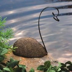 river stone and metal swan garden art