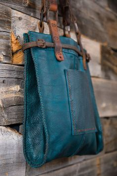 CIBADO leather bags Entirely hand sewn teal buffalo leather tote incorporating vintage horse tack to become handles and decorative detail.