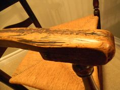 the arms and hand rests are very worn from about 250 years of use