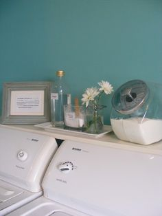 Shelf above top load washer/dryer. Definitely doing this to hide the ugly hoses and cords behind the washer and dryer.