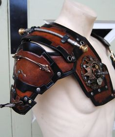 Brown and black leather steampunk shoulder armor on Etsy, $300.00