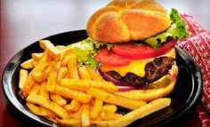 Groupon - $ 10 for $ 20 Worth of Burgers, Steaks, and American Fare at EATS! American Grill. Groupon deal price: $10.00