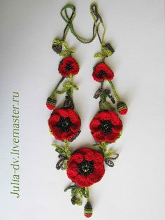 Poppies and other flower crochet necklaces and brooches.  No patterns but nice inspiration only.  Translation comes up but no details.  again, using for inspiration only.....very lovely.  ~ Di