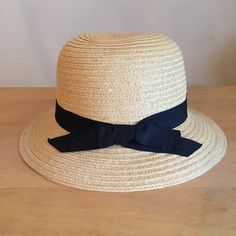 Forever 21 straw bucket sun hat - OS Worn a couple times. Great for spring, summer, & fall transition. Simple accessory for jeans, a t-shirt, & sandals; perfect with a skirt or dress for garden parties. Minor discoloration inside of brim from wear (make-up) - has been cleaned.  Forever 21 Accessories Hats