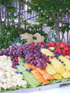 A beautiful fruit display with a pair of cantelope doves!