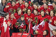 Team Canada wins Olympic gold Women's Hockey. Cassie Campbell team Captain.