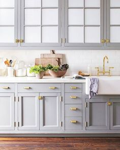 Trendy grey kitchen cabinets with gold details