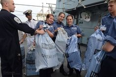 Sailors from HMS Northumberland bring BFPO mail onboard the ship during a port visit to Muscat in Oman during the ship's deployment to the area.