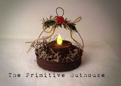 Primitive Handmade Christmas ornaments out of painted canning lids with battery tealight Primitive Christmas Ornaments, Christmas Ornament Crafts, Prim Christmas, Handmade Ornaments, Homemade Christmas, Christmas Projects, Holiday Crafts, Christmas Holidays, Christmas Decorations
