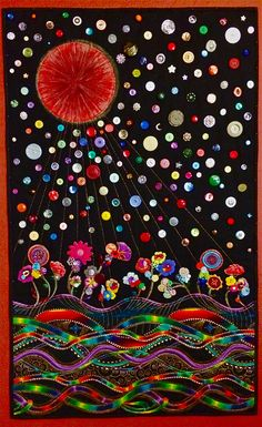 Vintage colored buttons and antique clear buttons adorn this appliqué art quilt of a blood moon over a night landscape.  Machine appliqué, machine free motion quilting and some fabric painting.