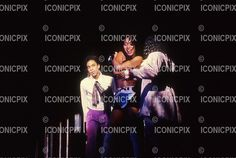 PRINCE - performing live with CAT (Catherine Glover) on the Lovesexy Tour at Wembley Arena in London UK - 25 Jul 1988.  Photo credit: George Chn/IconicPix