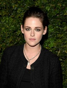 Kristen Stewart is known for her androgynous fashion choices. And, she was once again rocked an androgynous look while posing for the photographs at the Charles Finch and Chanel Pre-Oscar Dinner on February 27, 2016 at Madeo in Los Angeles. The 25 year old beauty opted to wear a lacy trousers with a floral pattern, perfectly balancing her black blouse and matching hued tweed jacket.
