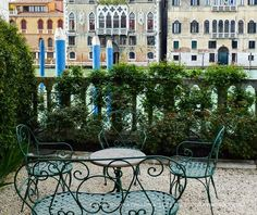Wrought iron garden furniture situated with Grand Canal view at Barnabo palazzo | The Decorating Diva, LLC #blogtourmilan #venice #gardens