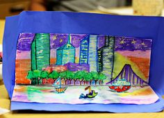 smART Class: city skyline prints This works best on regular zerox copy paper. First look at images of city skylines and talk about the shapes of the buildings, the sky and the reflections on the water. Then draw the city starting at the horizon line with trees, a road, and a bridge. Then draw the smallest buildings first so they can overlap the larger ones. They use a yellow crayon for the windows, stars, and fireworks, then color over them with marker to make a crayon resist when printed