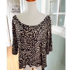 Soft rayon animal print top Leopard print top by  Janette features a wide boat neck, short dolman sleeves, soft rayon Janette Tops