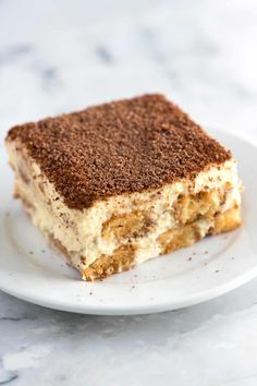 Tiramisu is one of our absolute favorite desserts. It is even simple to make, you just need a little time. Jump to the full Tiramisu Recipe now or watch our quick recipe video showing you how we make it. Köstliche Desserts, Delicious Desserts, Italian Desserts, Plated Desserts, Italian Recipes, How To Make Tiramisu, Simple Tiramisu Recipe, Dessert Thermomix, Cake Recipes