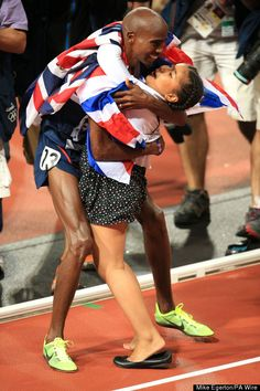 Great Britain's Mo Farah celebrates winning the Men's 10,000m final with his daughter Rihanna at the Olympic Stadium, London, on the eighth day of the London 2012 Olympics.