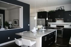 Beautiful black and white kitchen with a hint of blue-- Been wanting a kitchen like this.
