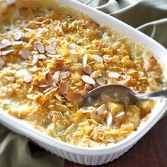 Reduced-fat cream of chicken soup and plain yogurt replace mayonnaise in this traditionally fat-laden dish. Top it off with a crunchy cornflake-almond topper.