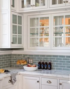 blue glass backsplash Love it with the white cabinets. I just love a soft blue with white.