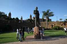 Young people hang out beneath a stature of former South African Prime Minister JBM Hertzog in the gardens of the Union Buildings. Only two decades ago, it would have been unthinkable for black people to walk freely around the presidential compound.