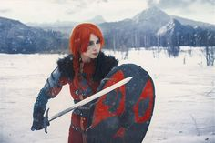 Cerys an Craite Cosplay by elenasamko female fighter knight paladin soldier viking sword shield redhead red hair costume LARP LRP armor clothes clothing fashion player character npc | Create your own roleplaying game material w/ RPG Bard: www.rpgbard.com | Writing inspiration for Dungeons and Dragons DND D&D Pathfinder PFRPG Warhammer 40k Star Wars Shadowrun Call of Cthulhu Lord of the Rings LoTR + d20 fantasy science fiction scifi horror design | Not Trusty Sword art: click artwork for…
