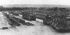 Red Ball convoy lineup-After the invasion of Normandy, it was of paramount importance to move supplies north.   An American infantry division required 150 tons of gasoline per day, and an armored division 350 tons per day.      Some of the supply lines were thousands of miles long, and the amount of provisions and munitions numbered thousands of tons.  This was almost ten times that of World War I.