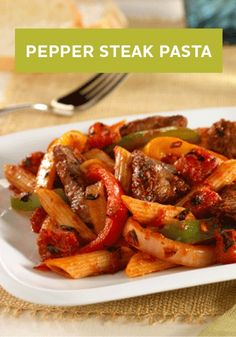 Pepper Steak Pasta -- Juicy strips of beef sirloin steak are tossed with bell peppers, onions, tomatoes, and pasta for one easy, 30-minute dinner!