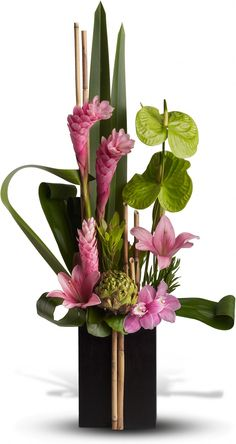 Unusual elements including pink ginger, green artichoke, river cane and green anthuriums make this Asian-inspired arrangement especially eye-catching. The tall, serene sculpture is presented in a dark wooden box for a very Zen effect.