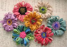 Hooked wool flower brooches by AutumnHathaway, via Flickr