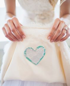Take an old dress shirt from of your father's (or another loved one that you'd like to honor) and cut out a heart to sew inside your dress...