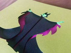 "Maleficent Layered Paper Cut Art Piece 5""x7"" Shadowbox Frame These Paper CutOuts are designed using Scale Vector Graphics and cut using a paper cutter for precision details. This piece has extra layers that"