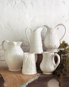 Would make great gifts filled with flowers or a small pine.  Five Assorted Pitchers - Horchow