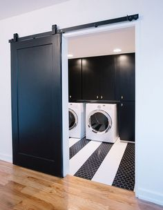 This black and white laundry room has two things we love: fun floors and a sliding barn door. Laundry Doors, White Laundry Rooms, Small Laundry, Folding Closet Doors, Barn Door Closet, Internal Sliding Doors, Black Barn, Black Doors, Laundry Room Design