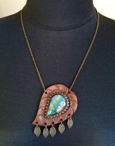 Hand tooled leather pendant with amazing blue fire labradorite and bronze chain - Artisan jewelry