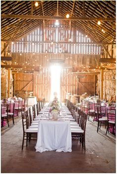 A breathtaking shot of a barn wedding reception by Jen Rodriguez Photography
