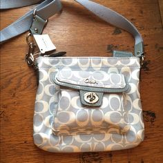 New Coach signature pocket swingpack New with tags signature pocket swingpack. tags are there, but price is ripped off because it was a gift.  Very cute just never got a chance to use it Coach Bags Crossbody Bags