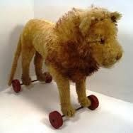 Image result for steiff lion on wheels