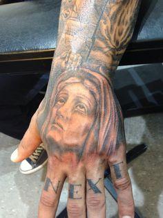 Virgin Mary hand tattoo